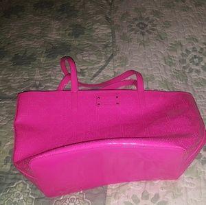 Neon pink Kate Spade shoulder bag.